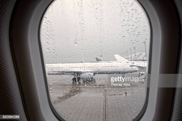 Looking at parked Planes in the rain