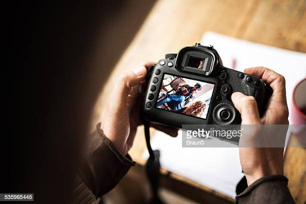 Looking at photos from a digital camera.