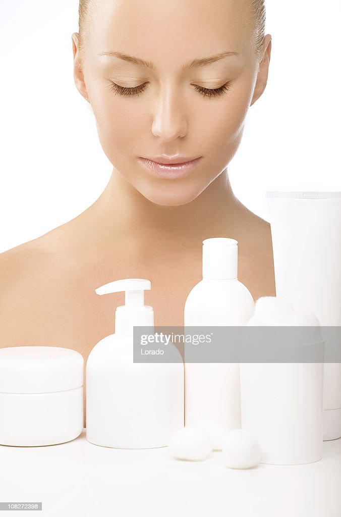 looking at the cosmetics beautiful woman : Stock Photo