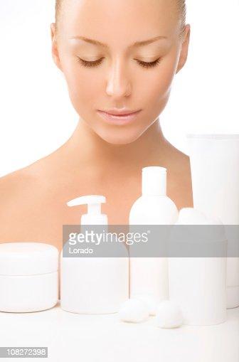 looking at the cosmetics beautiful woman : Stock Photo