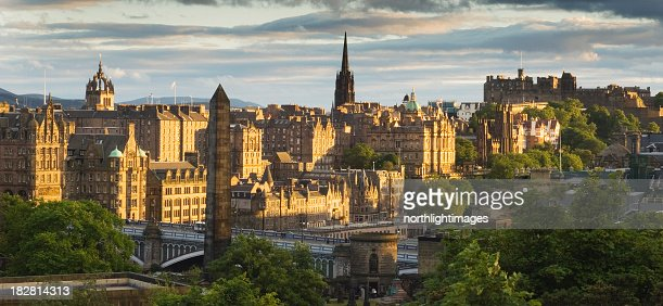 Looking down at Edinburgh as the sun sets over the city