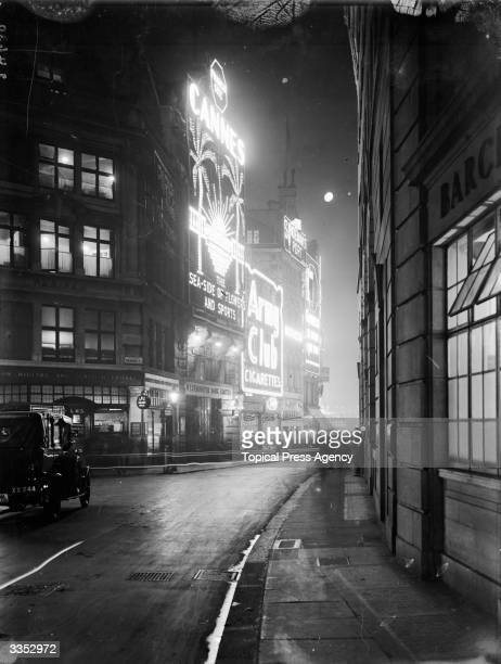 Looking down Glasshouse Street to the junction with Sherwood Street and towards the lights of Piccadilly Circus in London