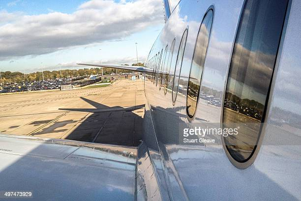 CONTENT] Looking down the fuselage of a passenger plane