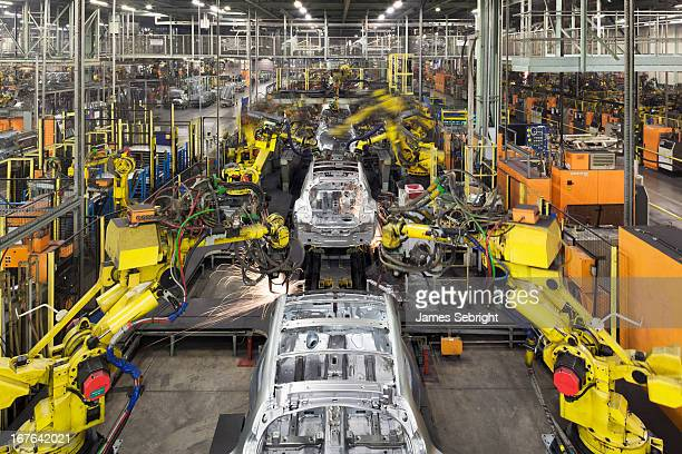 CONTENT] Looking down the length of the plant robotic arms assemble and weld body shells cars on the production line at Nissan's Sunderland plant The...