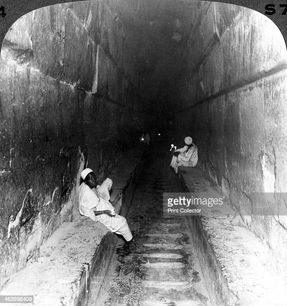 'Looking down the main passage to Khufu's sepulchre within the Great Pyramid Egypt' 1905 'Up this superb hall the body of the king was borne on the...