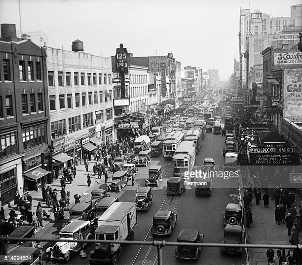 Looking east from 8th Avenue at the traffic and buildings on 125th Street in Harlem Manhattan The Apollo Theater is at left Riots broke out here...