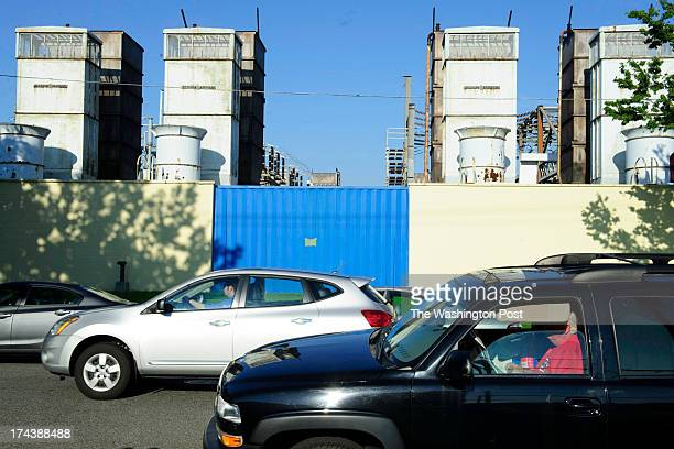Looking east from First Street SW between S and T streets Steve Sinclair reads a newspaper in his car parked in Buzzard Point before attending a...