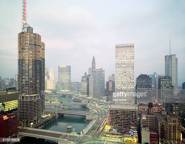 Looking east with Chicago River in pictures buildings are Marine City Chicago SunTimes and Daily News Wrigley Tower Equitable Insurance building 333...