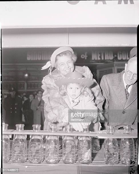 Looking extraordinarily attractive Mrs Eleanor Roosevelt smiles her prettiest as she holds four year old Linda Brown the 1949 March of Dimes Poster...