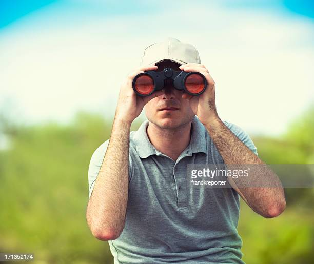 Looking forward man with binocular