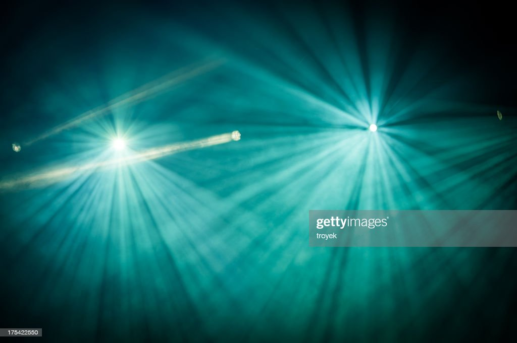 Looking into two full stage lights and spotlight to left
