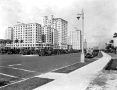 Looking north on Biscayne Boulevard at Flagler Street in Miami with the McAllister Hotel at left front and Bayfront Park to the right Miami Florida...