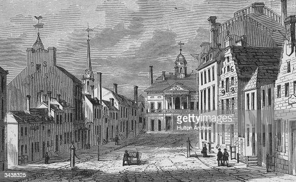 Looking north on Broad Street towards Wall Street and Federal Hall in the financial district of New York City