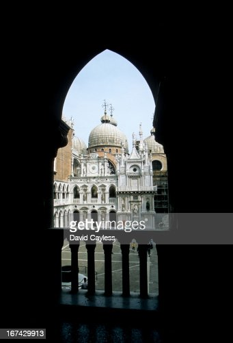 Looking out from an archway : Stock Photo