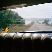 Looking out from the back of a car, Sweden.