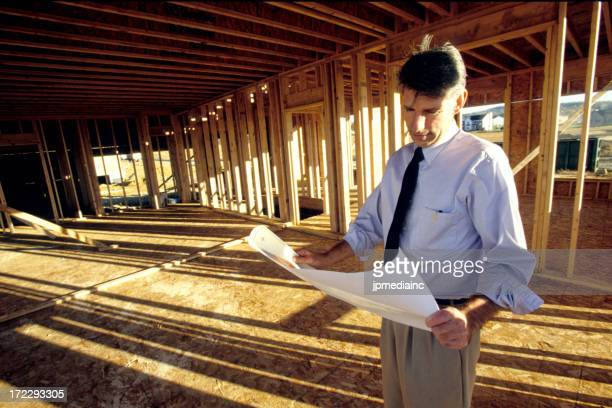 looking over site plans