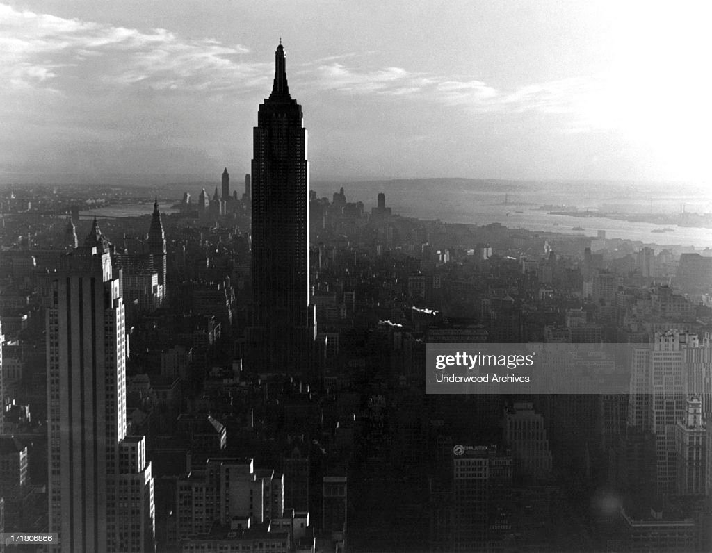Looking south at sunset at the Empire State Building and midtown Manhattan, New York, New York, circa 1938.