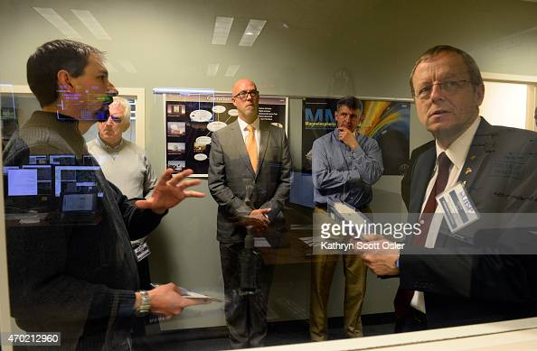 Looking through a lab window Darren Osborne left Flight Director at LASP shows the delegation including Professor Jan Woerner right chairman of the...