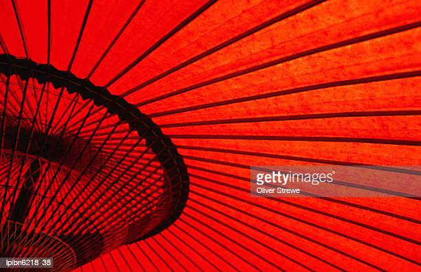 Looking through red bangasa, an oiled rice paper umbrella, Japan, North-East Asia