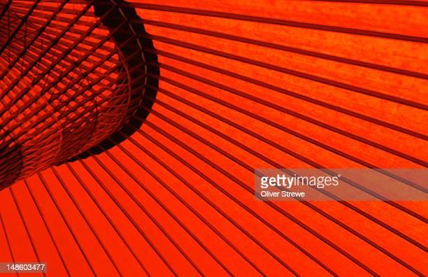Looking through red bangasa, an oiled rice paper umbrella- Japan