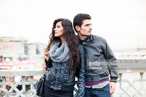 Looking To Different Directions - A Couple On The Bridge
