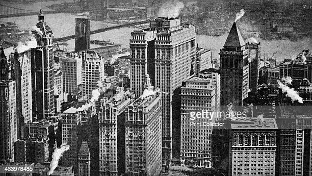Looking towards Brooklyn over the skyscrapers of Broadway New York City USA c1930s The East River and the Brooklyn Bridge are visible in the...