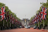 Looking towards Buckingham Palace British Union flags hang above The Mall in central London on June 8 as Britain prepares to celebrate the 90th...