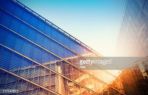 Looking up at a modern glass building