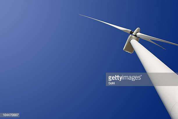 Looking up at a white wind turbine
