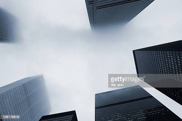 Looking Up at Skyscraper Office Buildings with Fog