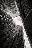 Looking at the sky between skyscrapers in New York City
