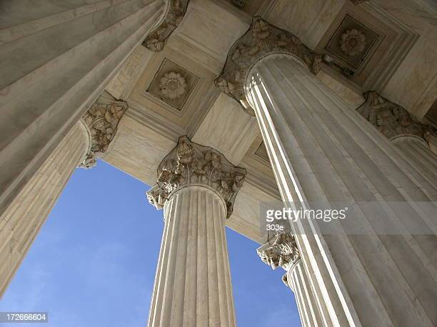 Looking up at the majestic white columns of Supreme Court