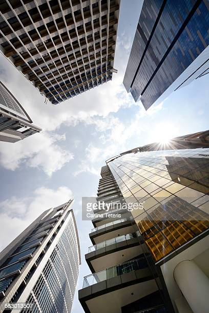 Looking up at the sun through high rise buildings