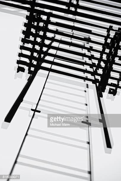 Looking up fire escape ladder