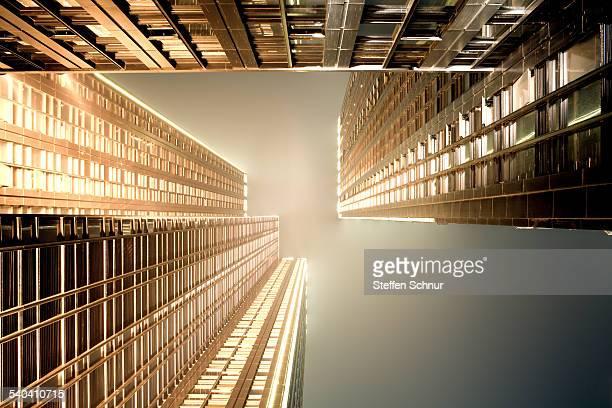 Looking upwards golden skyscrapers clear lines
