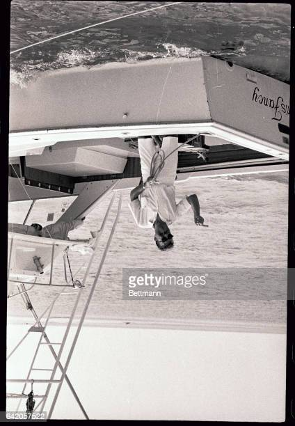 Looking very much like a man of leisure former New York Congressman Adam Clayton Powell gestures to newsmen as he ties up his boat before a dockside...