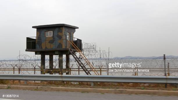 Lookout tower and Barbed wire fence separates South from North Korea Asia