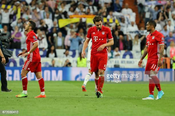 looks dejected Thiago Alcantara of Munich Mats Hummels of Munich Douglas Costa de Souza of Munich during the UEFA Champions League Quarter Final...