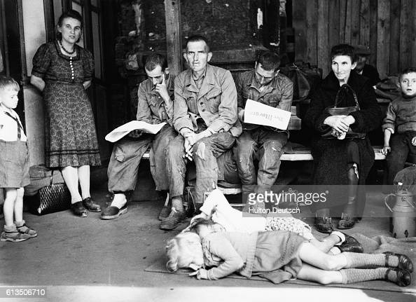Looks of resignation and sadness on the faces of women and members of the German armed forces at Berlins' Lehrter railway station five months after...