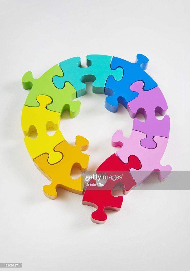 Loop rainbow coloured puzzle, a piece breaks away