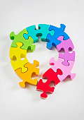 Loop rainbow coloured puzzle, a piece breaks away