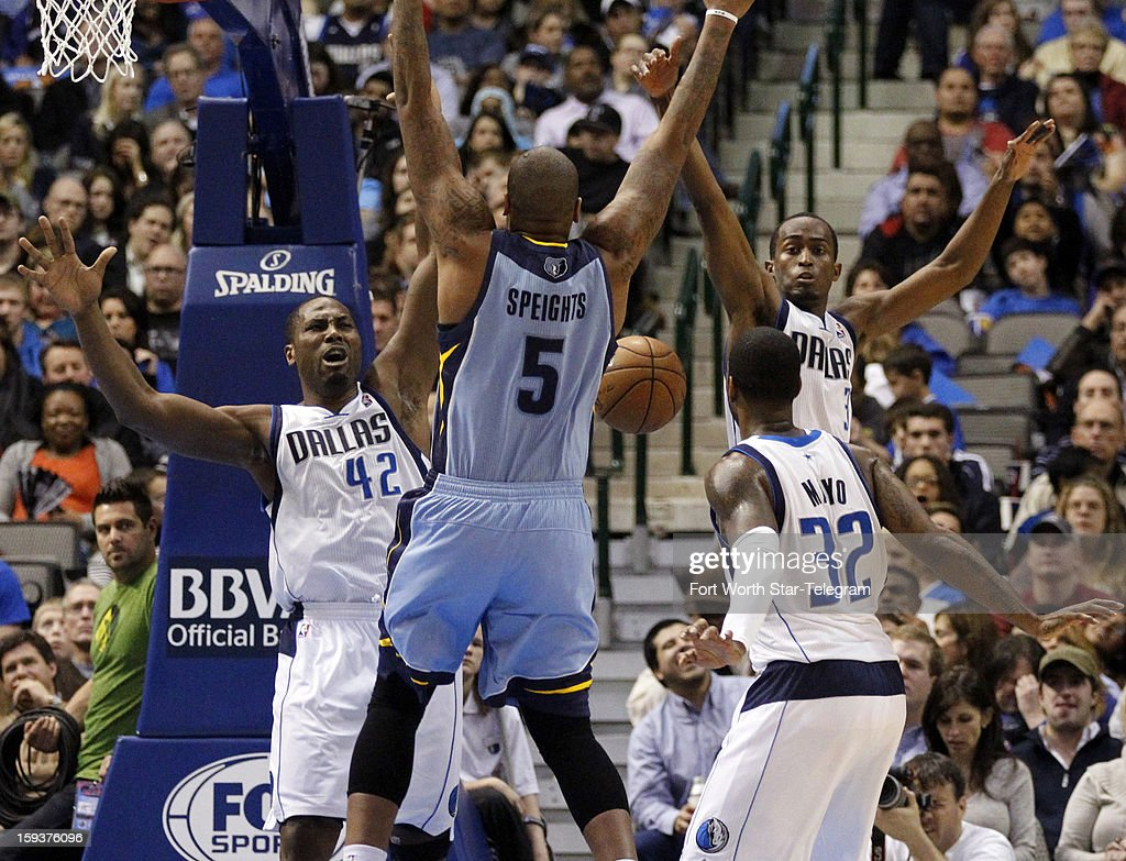 A loose ball bounces freely between Memphis Grizzlies power forward Marreese Speights (5) and Dallas Mavericks power forward Elton Brand (42), shooting guard O.J. Mayo (32) and point guard Rodrigue Beaubois (3) during the fourth quarter at the American Airlines Arena in Dallas, Texas, Saturday, January 12, 2013. The Mavericks beat the Grizzlies, 104-83.