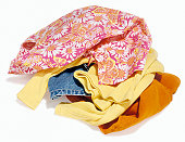 Loose pile of dirty laundry stacked for wash