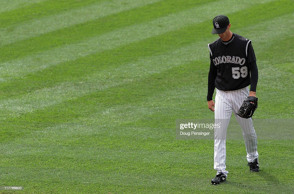 Loosing pitcher Clayton Mortensen #59 of the Colorado Rockies leaves the mound after giving up what would be the game winning hit to Juan Pierre #1 of the Chicago White Sox in the 10th inning during Interleague play at Coors Field on June 30, 2011 in Denver, Colorado. The White Sox defeated the Colorado Rockies 6-4 in 10 innings.