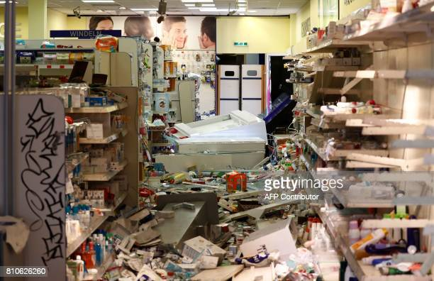 A looted Budnikowsky drugstore in Hamburg's Schanzenviertel district is pictured on July 8 2017 in Hamburg northern Germany where leaders of the...
