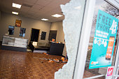 A looted cell phone store is seen the morning after violent protests damaged businesses following the grand jury announcement in the Michael Brown...