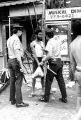 Looter is arrested during 1977 Blackout Power Failure at Utica and Eastern Parkway