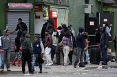 Looters break into stores along Pennsylvania Avenue during violent protests following the funeral of Freddie Gray April 27 2015 in Baltimore Maryland...