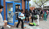 Looters empty the CVS at Pennsylvania and North Avenues during riots on Monday April 27 in Baltimore