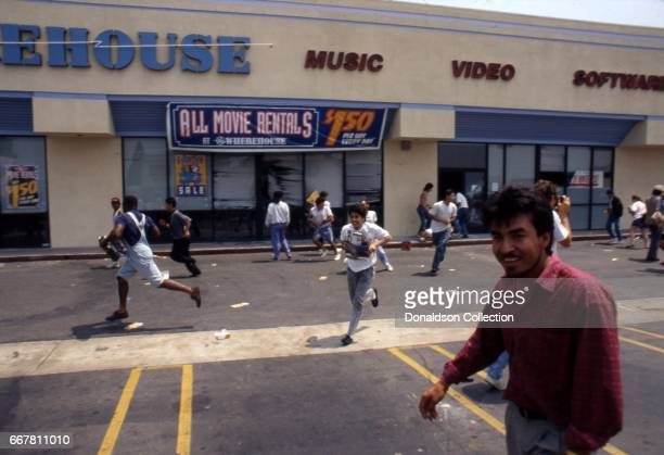Looters outside a Wherehouse video store at a shopping center located at 116 S Vermont Ave in widespread riots that erupted after the acquittal of 4...